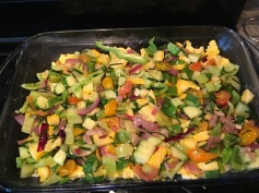 Spread cooked vegetables over the cooked scrambled eggs.
