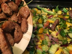Place a layer of sausage over cooked vegetables