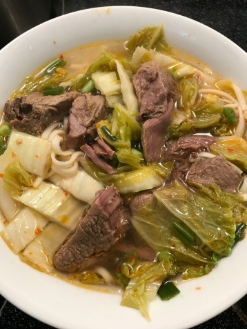 Add the beef soup over the noodles.